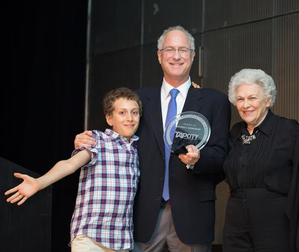 George T. Nierenberg receiving the American Tap Dance Foundation Tap Preservation Award in 2014 for the superior advancement of tap dance through presentation and preservation. (George's son Jack, George, George's mother Juliet.
