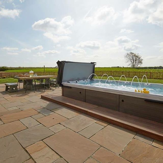 ⭐️ 🍾 Luxury Holiday Barn with Large Swim Spa 🍾⭐️ Lincolnshire Various Dates August 2019 7 Nights ➡️➡️➡️ £267 per person  Based on 10 sharing Total price £267 5 Bedrooms ❤️ Private Swim spa for 10 people 💙 Barbecue 🖤 Bike Store 💛 Patio 💚 Wood burning Stove 💜 Wifi 💗 52'' Smart TV ❤️ DVD player and iPod dock 💙 Luxury Collection Bed Linen & Towels Included 🎣 Fishing Nearby 🚘 Private Car Parking ⛳️ Golf Nearby  Lying just 5 miles from the centre of Lincoln, these four luxury holiday barns are nestled on a quiet, no-through country lane with the owners living nearby. Each barn is arranged around its own private inner courtyard, and they also have a swim spa, with the facility to comfortably seat 10 people, which can be used as a hot tub to relax in after a day exploring the area. For those who enjoy wildlife, there is a 50-acre nature reserve further down the lane, close to the barns, where there are excellent walks and opportunities for bird watching. On site, there is a large well-stocked coarse fishing lake which has seating, making this an ideal place to relax and enjoy the tranquillity of the surroundings and while away the days whilst fishing. ⚠️ no pets allowed ⚠️ Please call for deposit and additional information ☎️ 01472 897333 ☎️#visitlincolnshire #luxurybarn #swimspa #sleeps10 #fishing #countrysideretreat #golfnearby #familytime