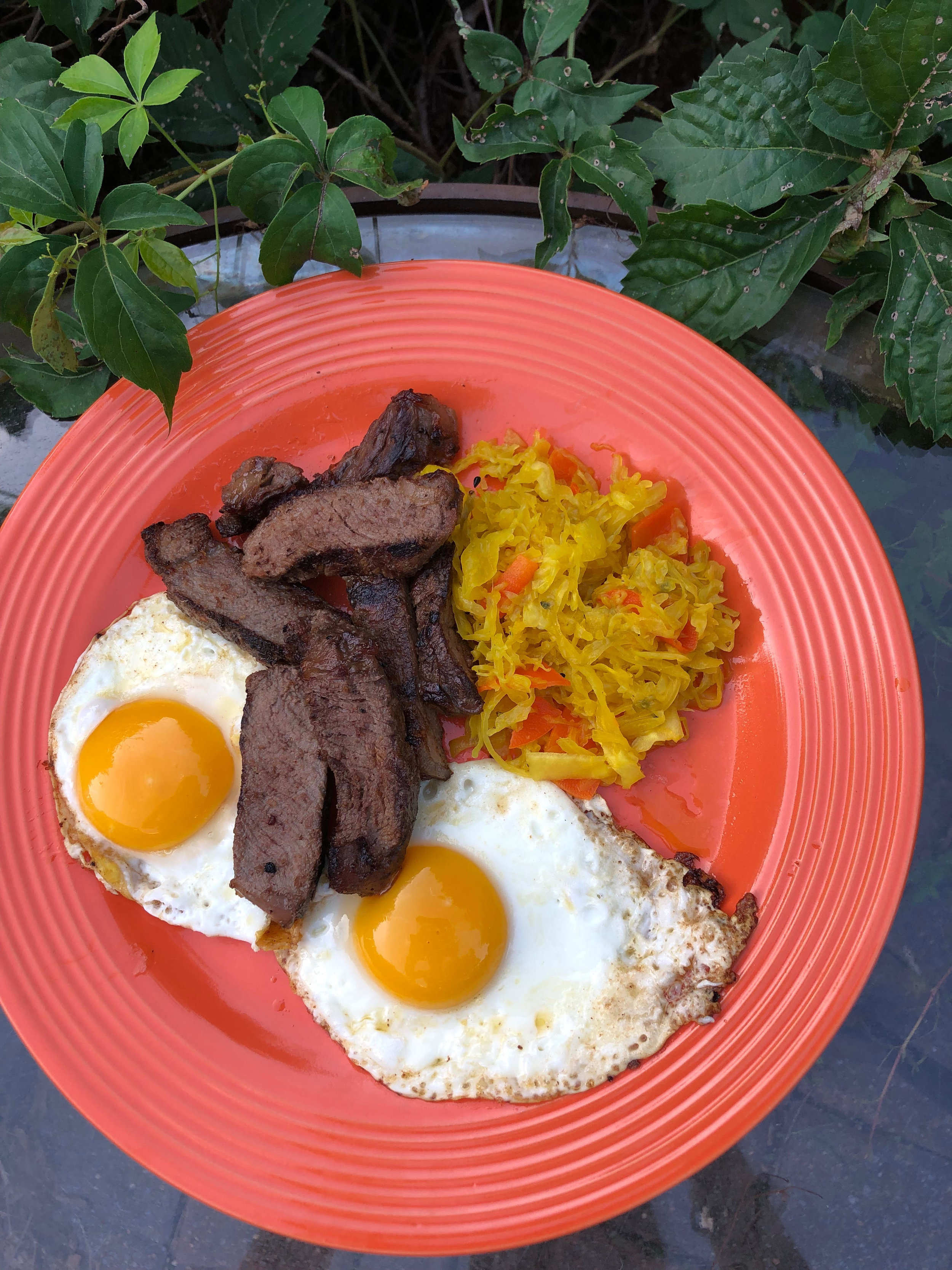 Simple and nourishing: here's a breakfast of steak, eggs, and ginger sauerkraut. Beats cereal any day, wouldn't you say?!