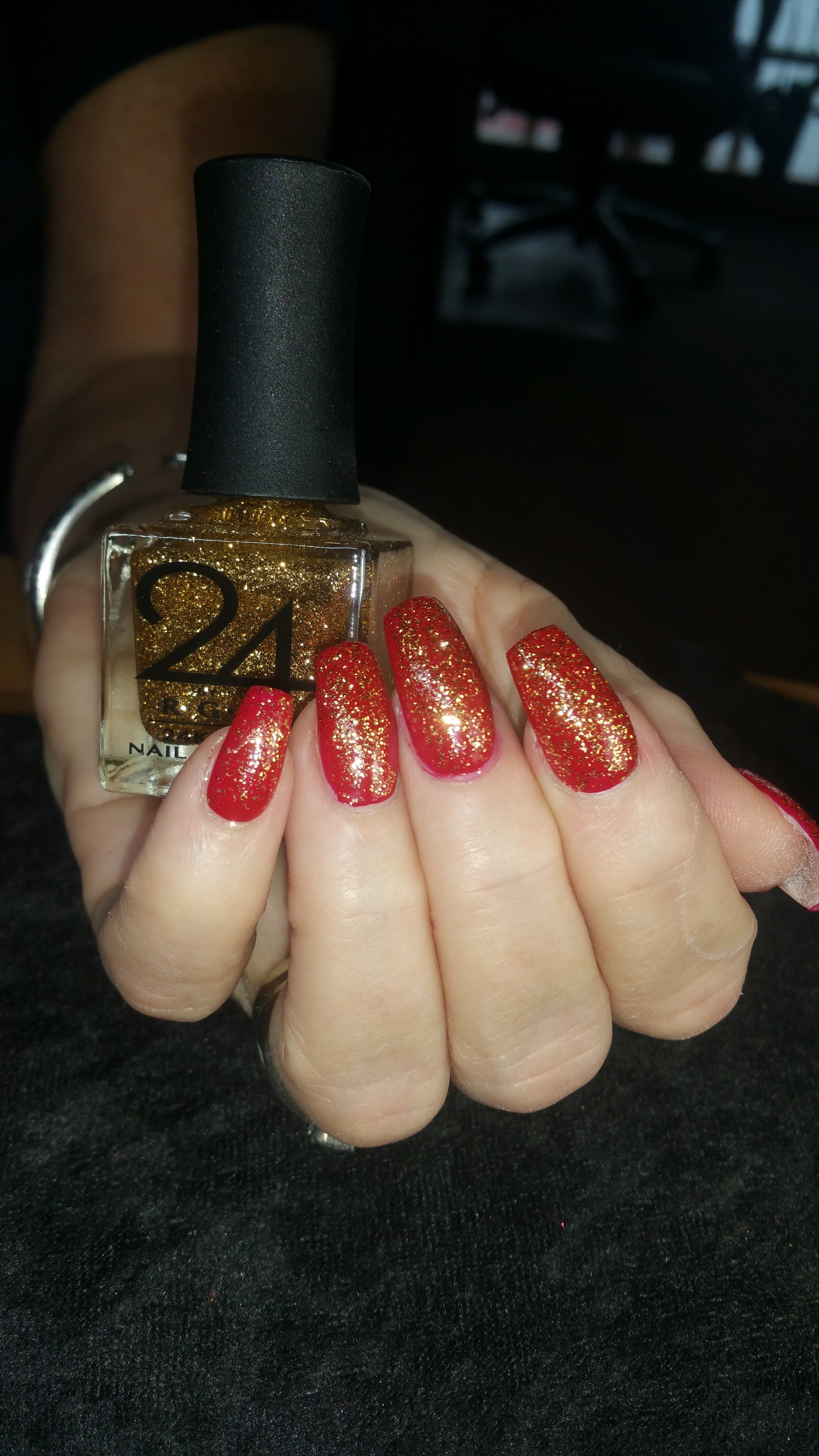 24kt Gold over red with bottle.jpg