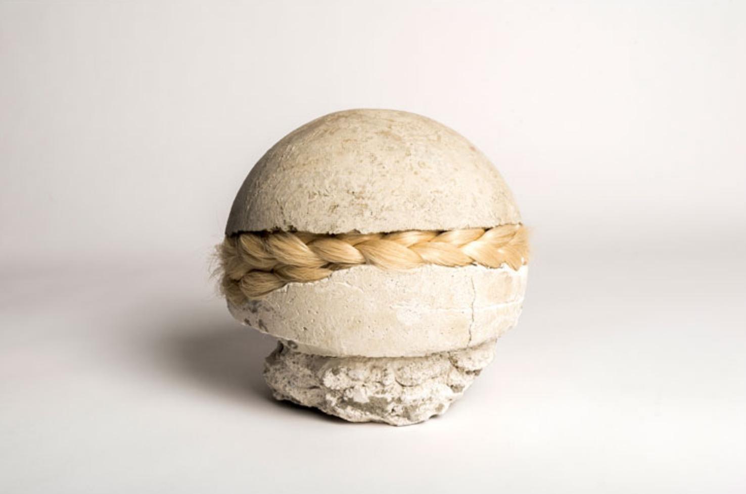 Veronica A Pérez,  wrecking ball , mortar, hair, 15 x 7 inches, 2016.