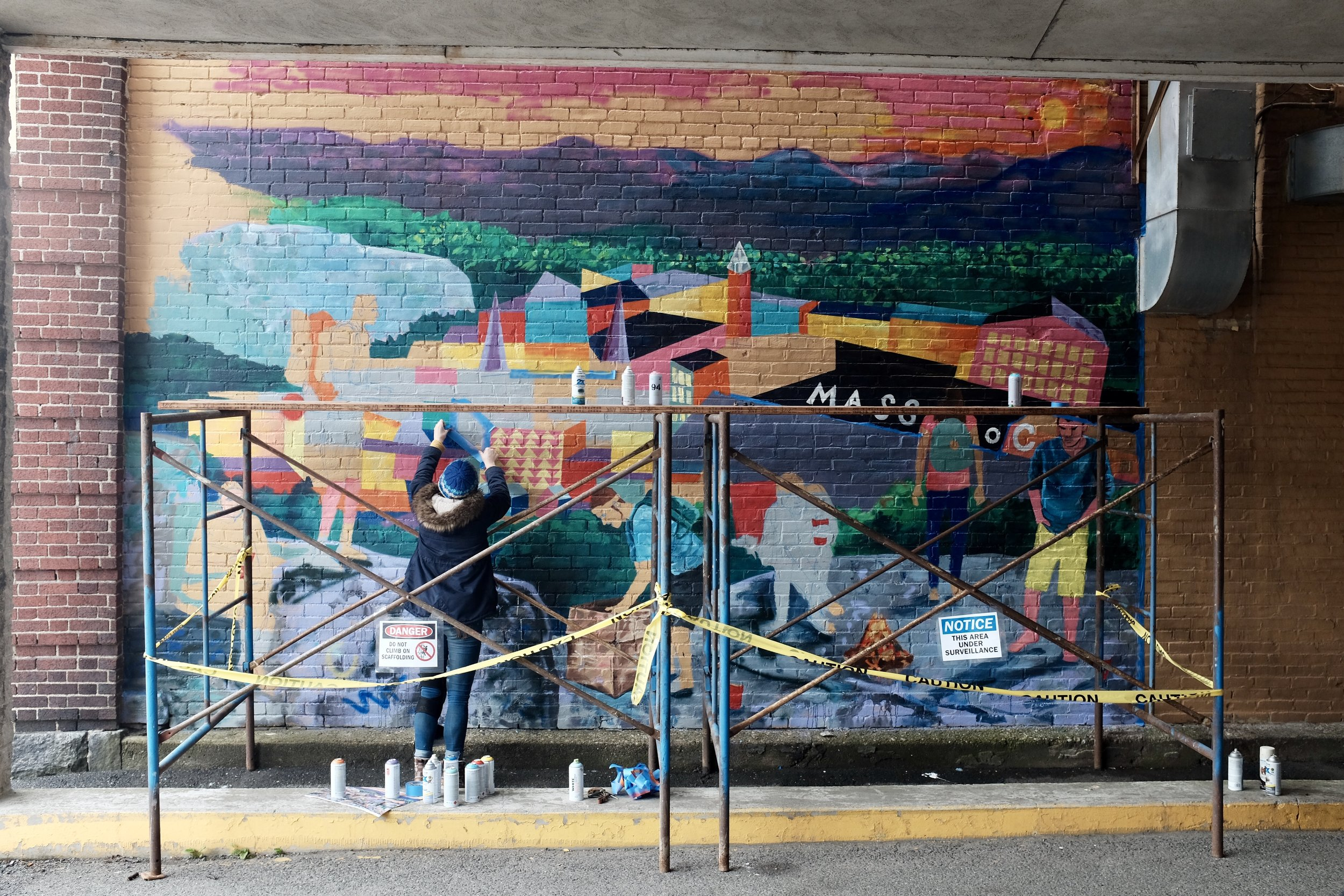 North Adams Project artist Danielle Klebes working on a downtown mural.