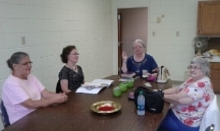 WMU Ladies Working on the Water Filtration Ministry and Other Mission needs.