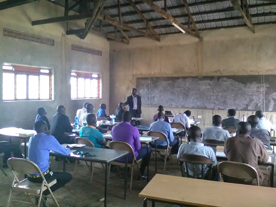 Pastor Raymond teaching a class for church workers in training.