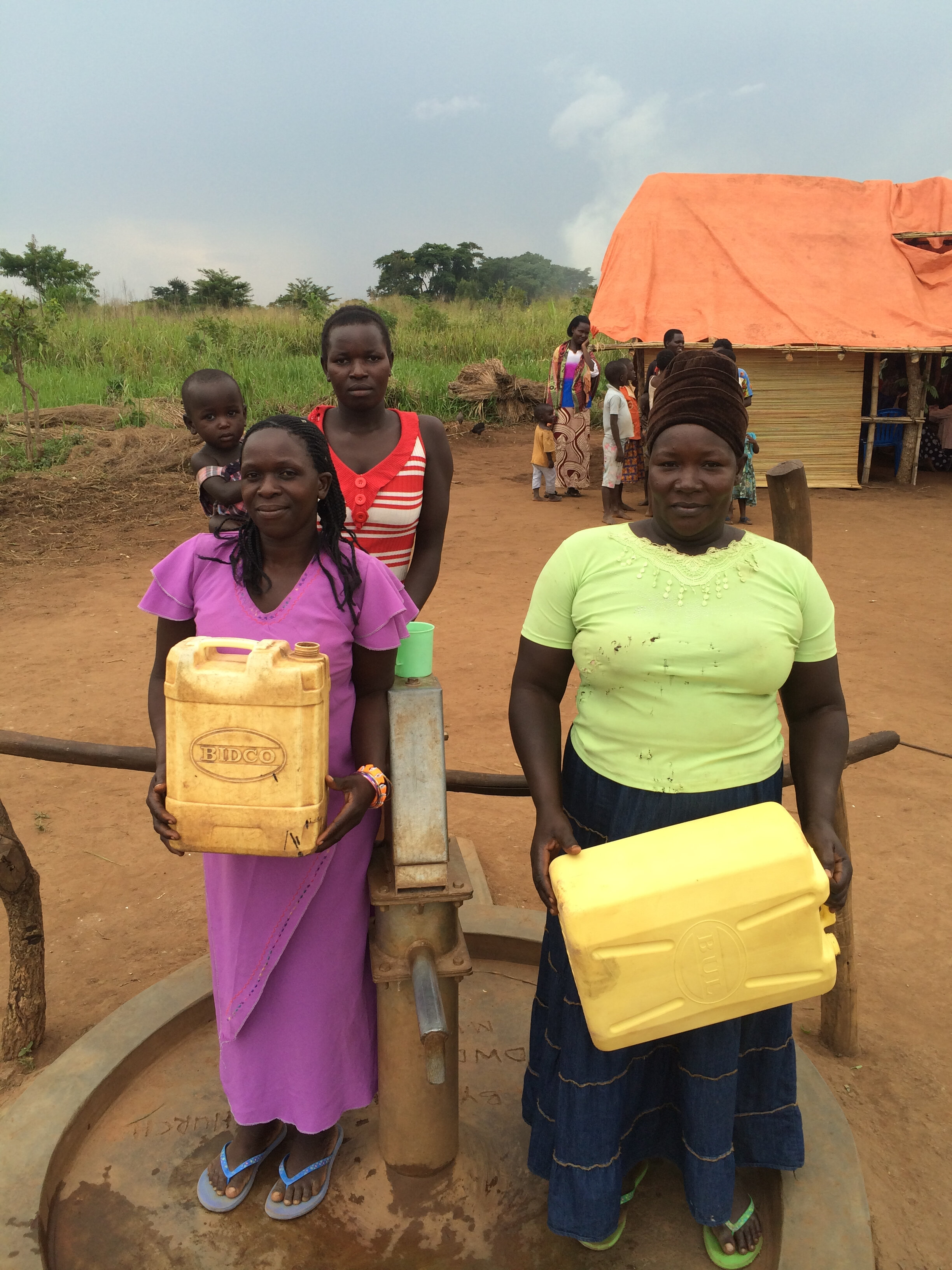 Some ladies fetching water from a new clean water well.