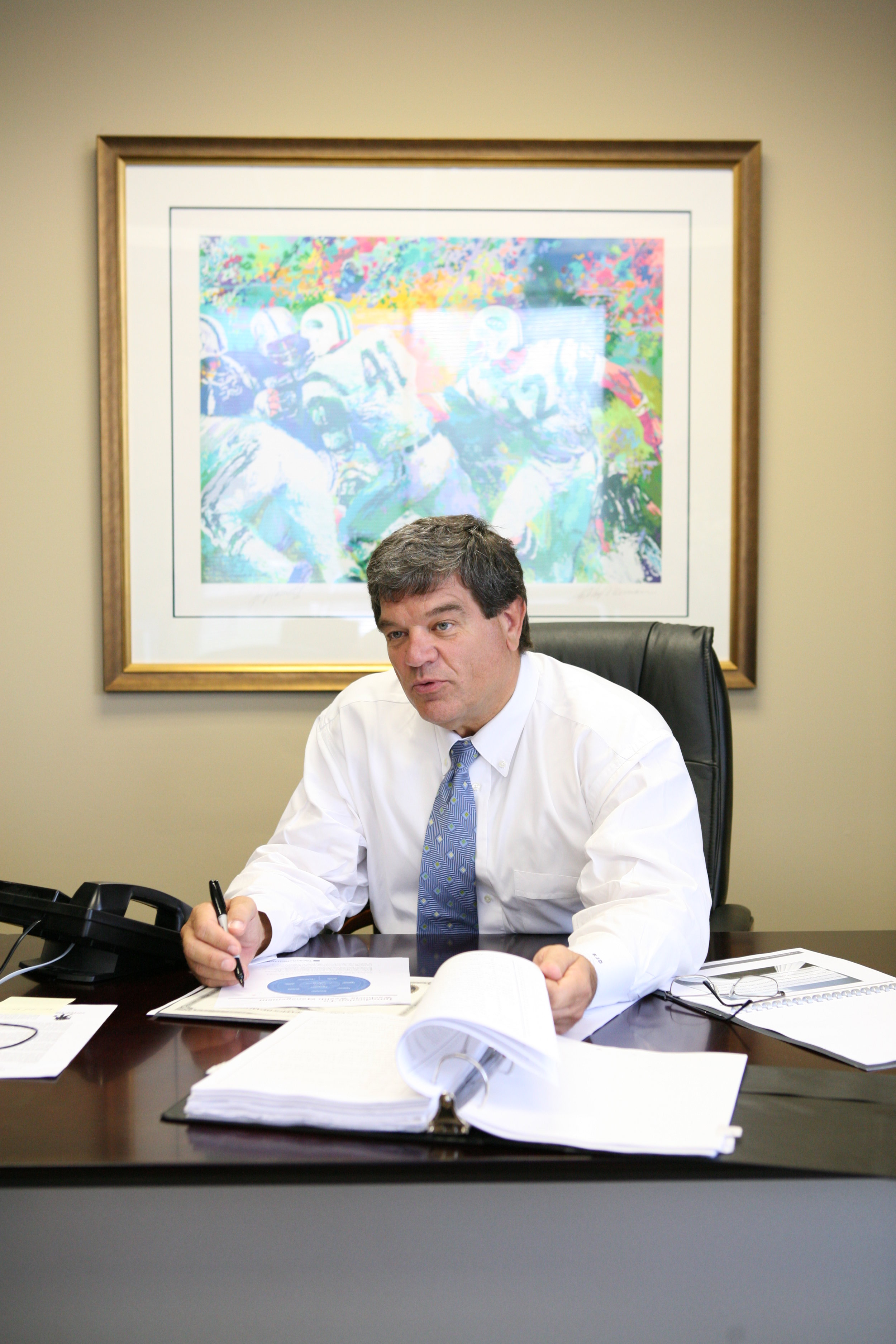 Picture of Roger J.  Dodd at his desk.
