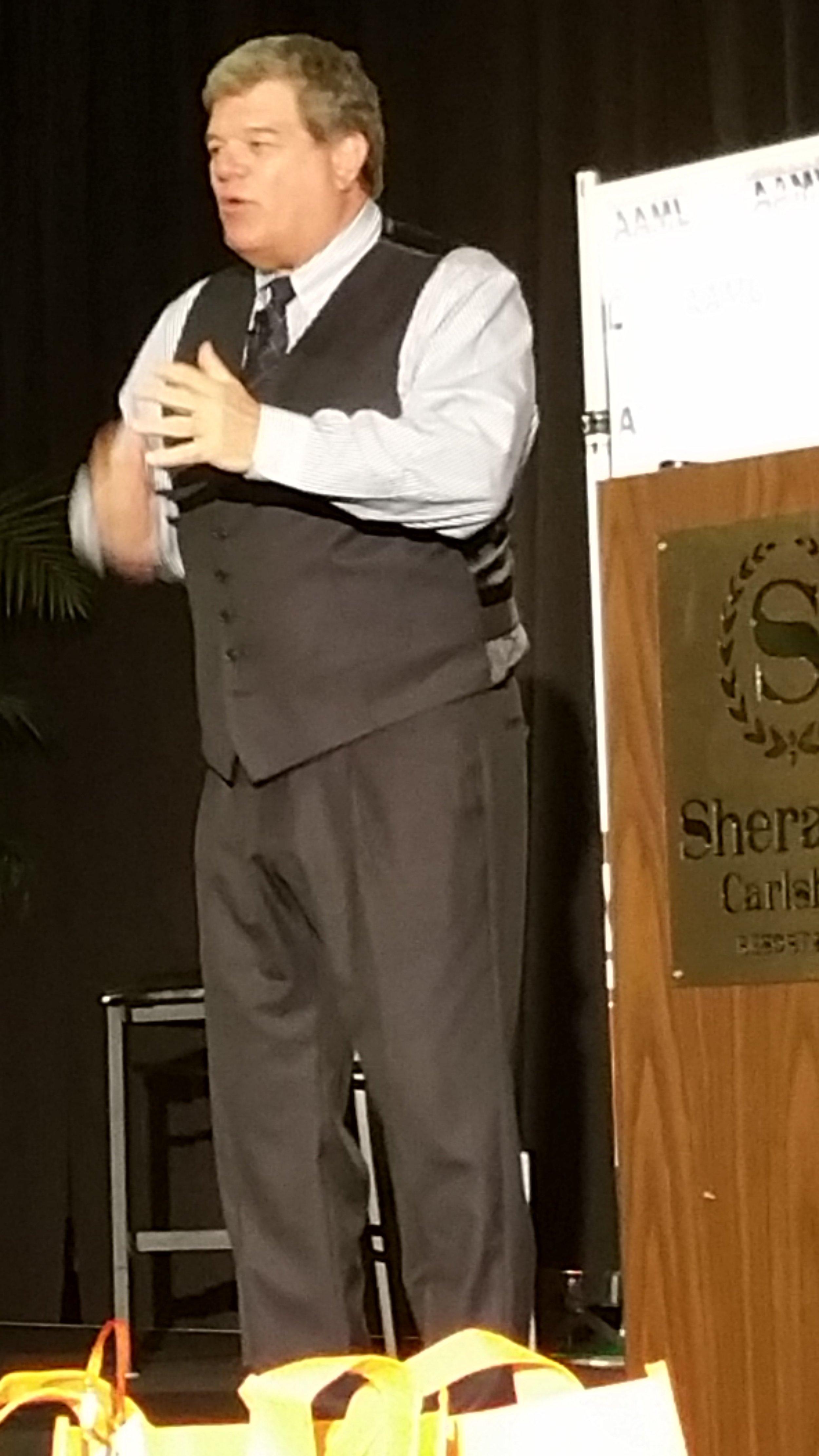 Picture of Roger J. Dodd speaking.