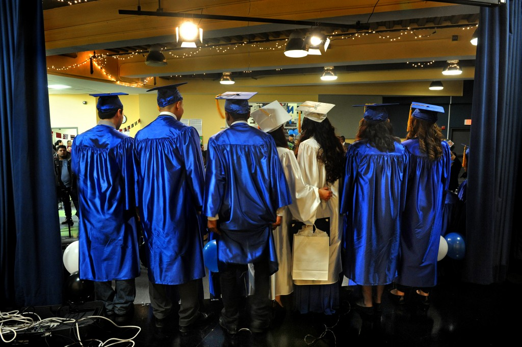 .Graduates line up to have their pictures taken at Next Step. The District is considering a proposal to give diplomas to GED recipients. (Michael S. Williamson/The Washington Post)
