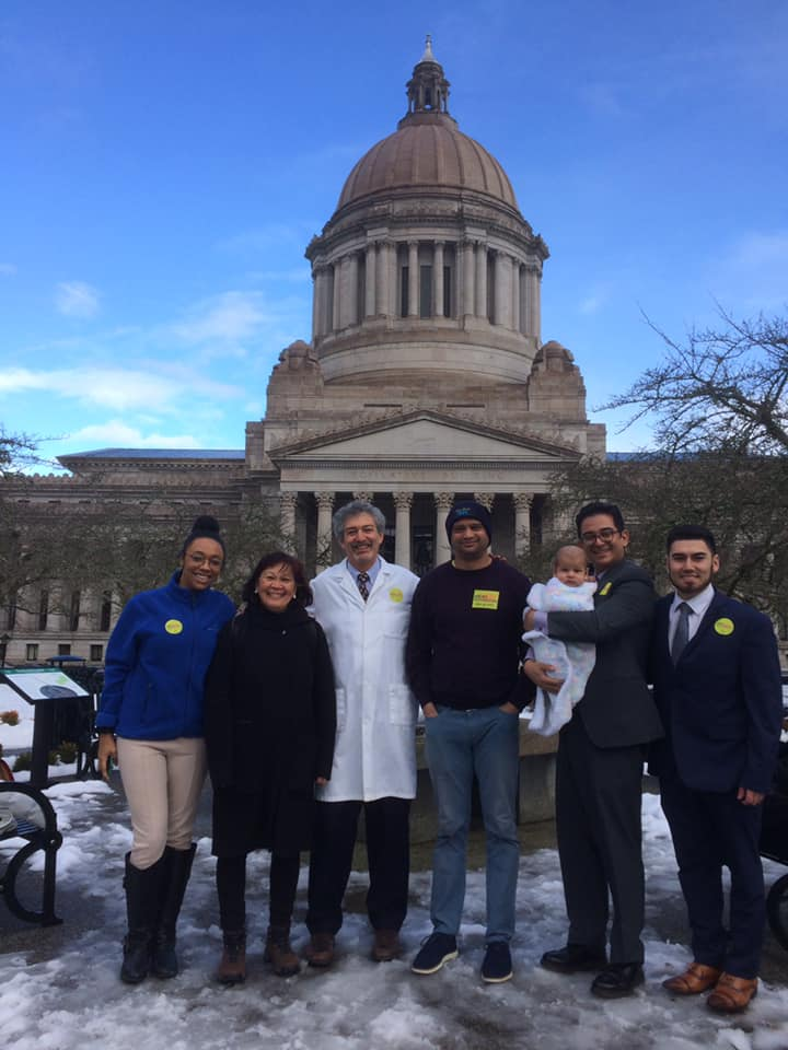 Ken standing outside the state capitol in Olympia with Front & Centered leaders and staff.