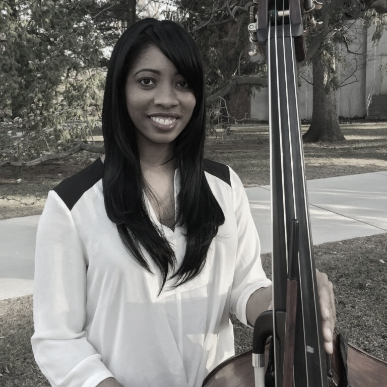 Dr. Joy Rowland    Double Bass   Maryland native Joy Rowland graduated from the Peabody Conservatory of the Johns Hopkins Institute where she received her Bachelors degree in double bass performance in 2009. While at Peabody, Joy studied with John Hood of the Philadelphia Orchestra. She then went on to receive her Masters degree in 2011 and her Doctorate Degree in 2016 at Michigan State University under the tutelage of Professor Jack Budrow of the North Carolina Symphony.  She has participated in summer programs such as the National Symphony Orchestra Summer Music Institute in 2004-05, the Gateways Music Festival in 2013 and 2015, which promotes minorities in the arts, and the National Repertory Orchestra in 2015.  In addition to teaching and being a member of both the Ann Arbor and Midland symphonies, she frequently subs with the Grand Rapids, West Michigan, and Lansing Symphonies.