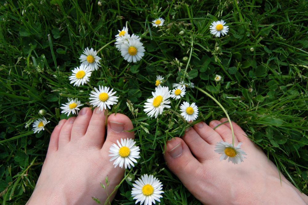 Grounding barefeet on the grass