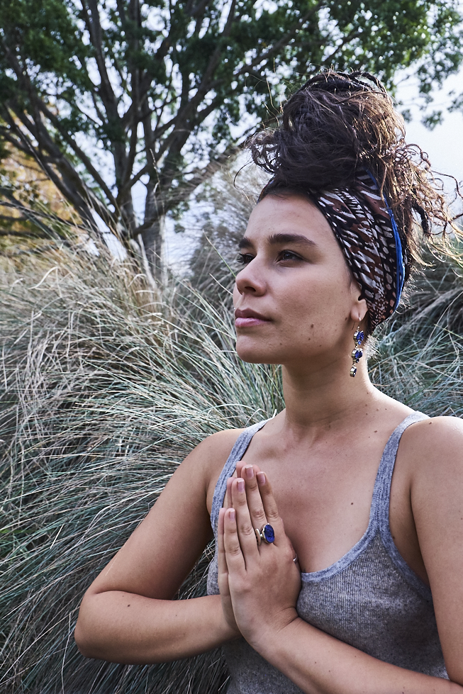 Bringing our hands into prayer position sends out our hearts intention to the universe. Photograph by Adam Singer