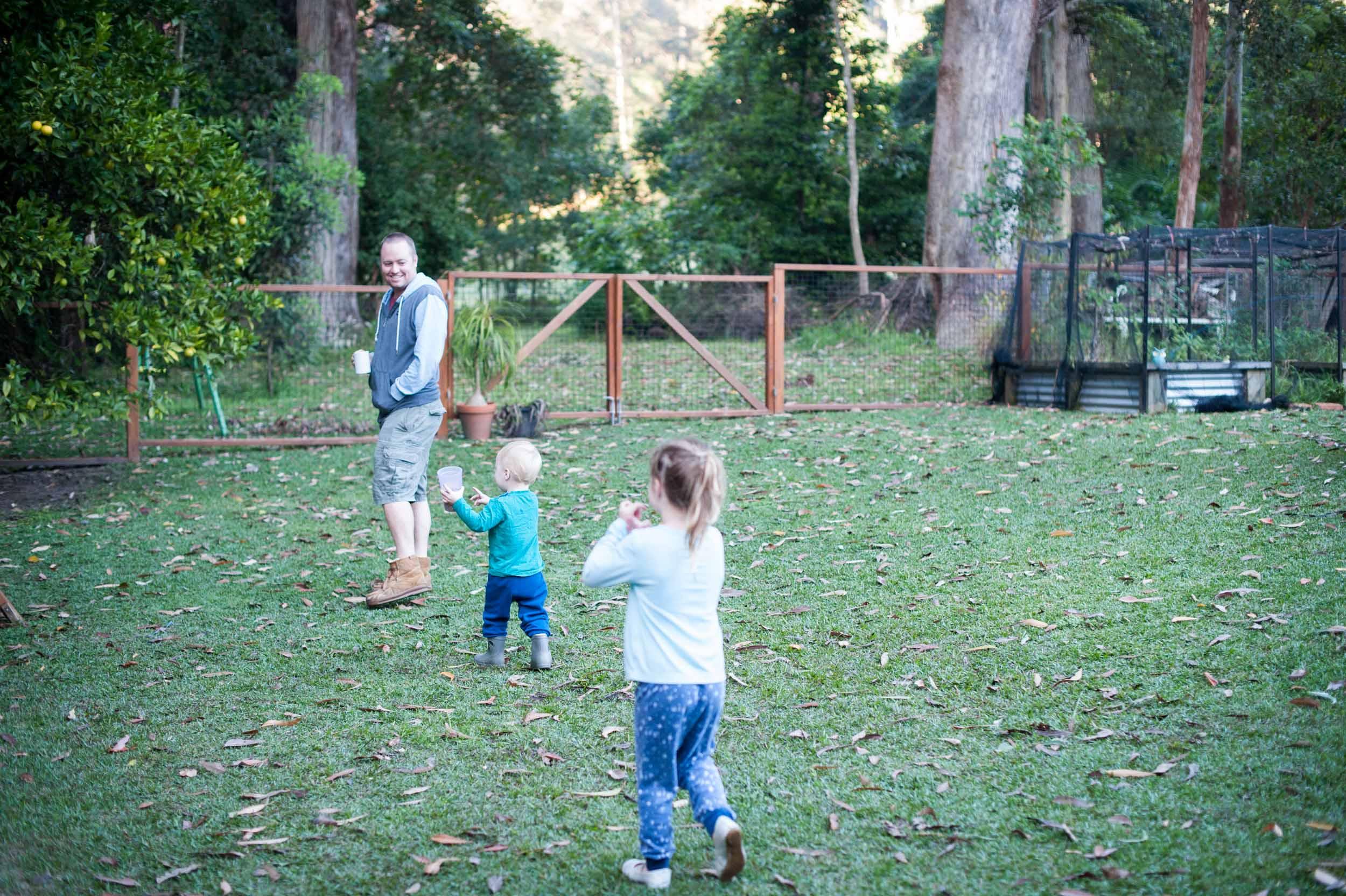 Family walking in back yard