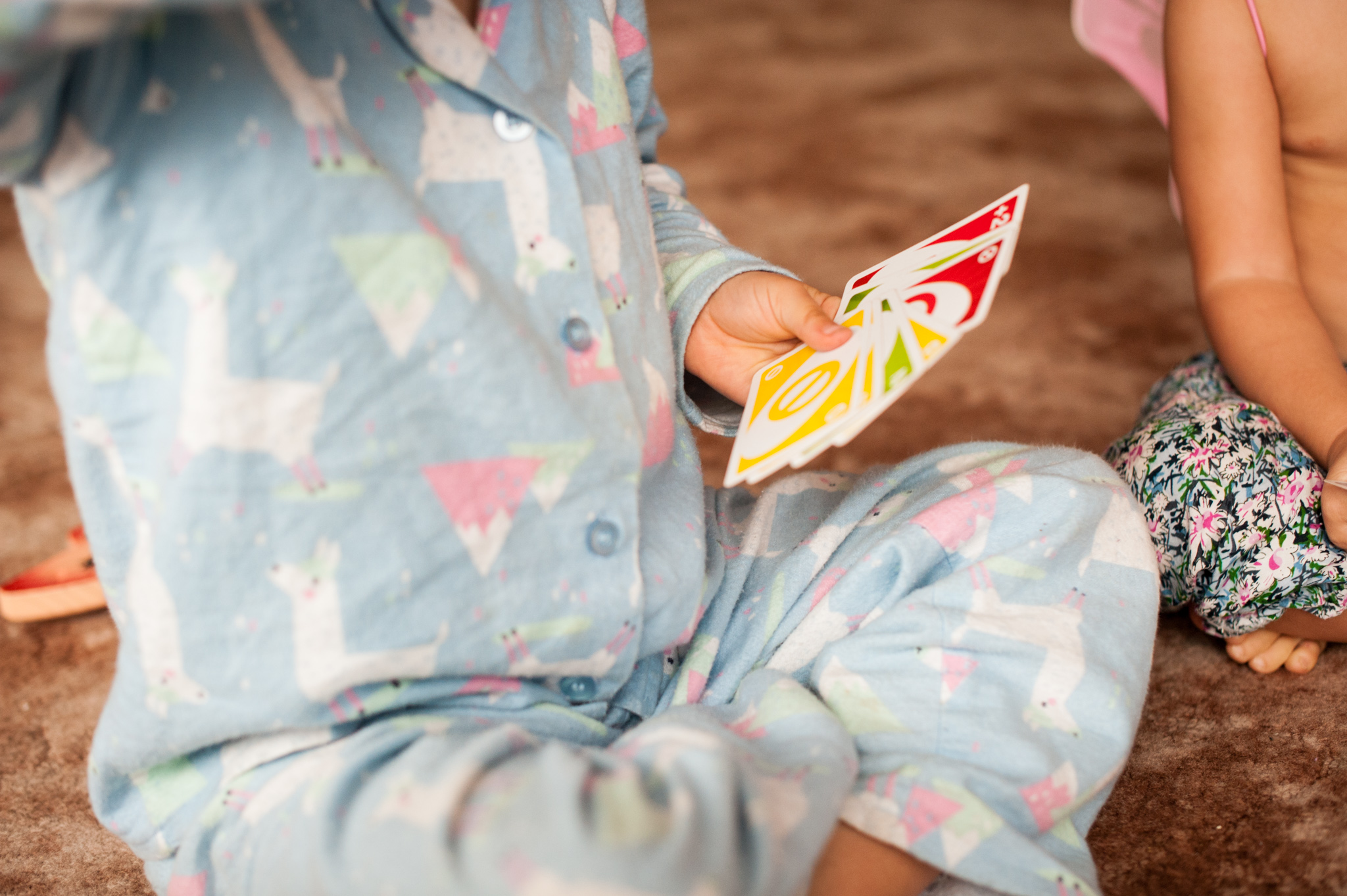 Playing UNO in pajamas