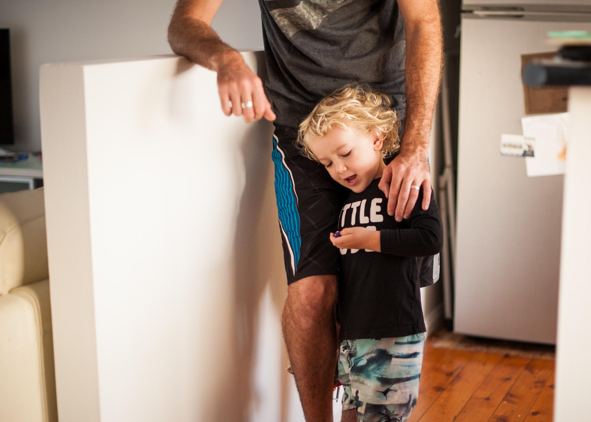 Little boy telling dad a story