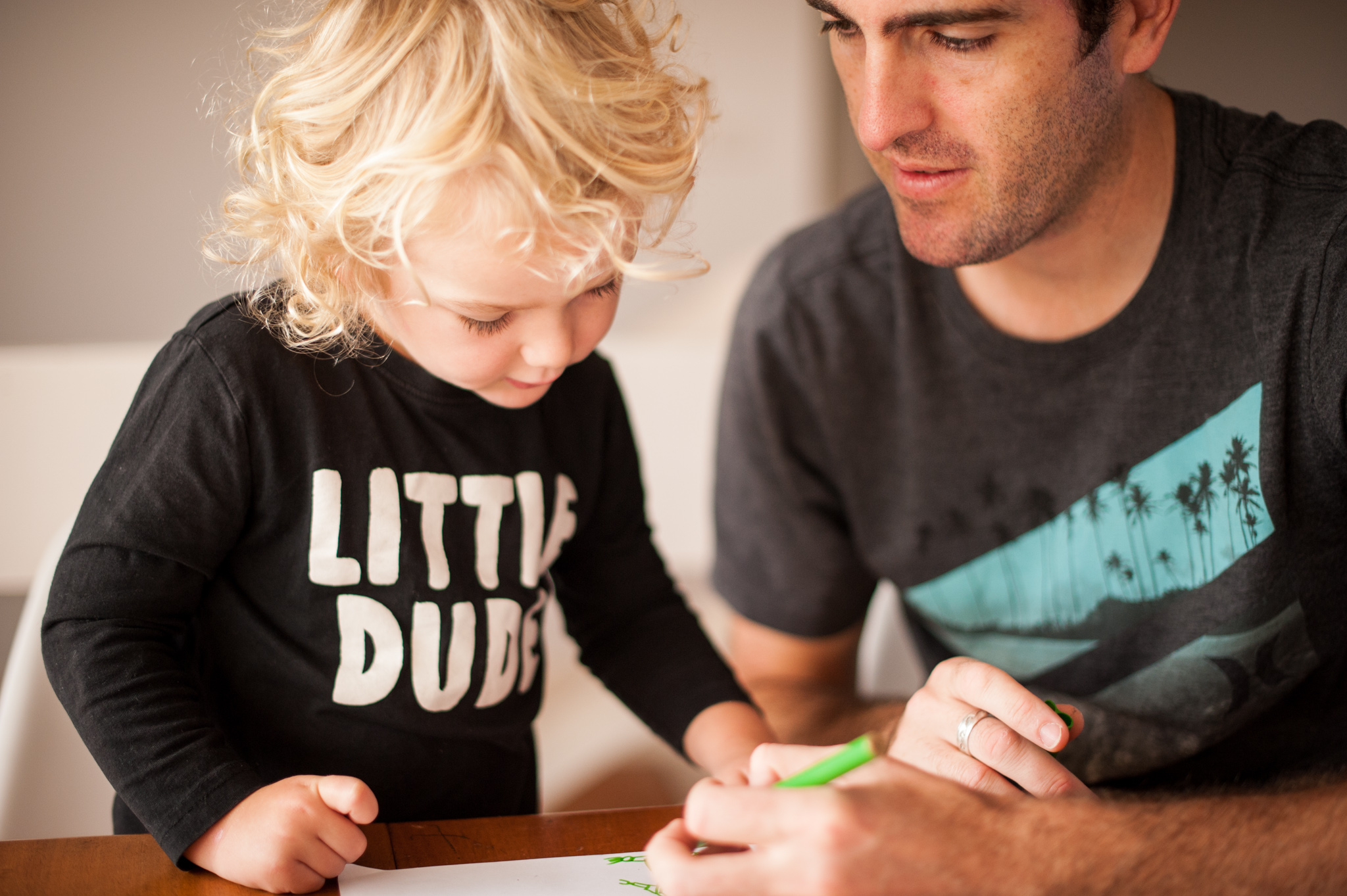 Father and son drawing superheroes together