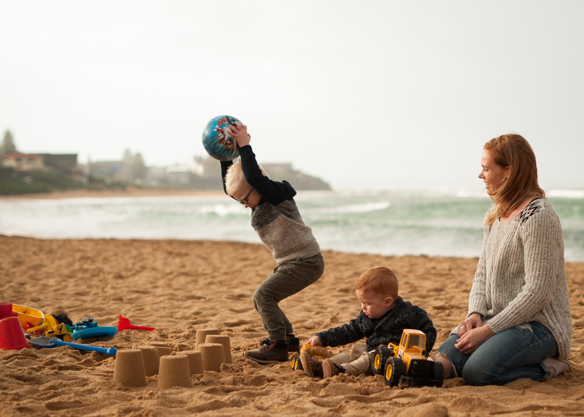 Throwing ball at sandcastles