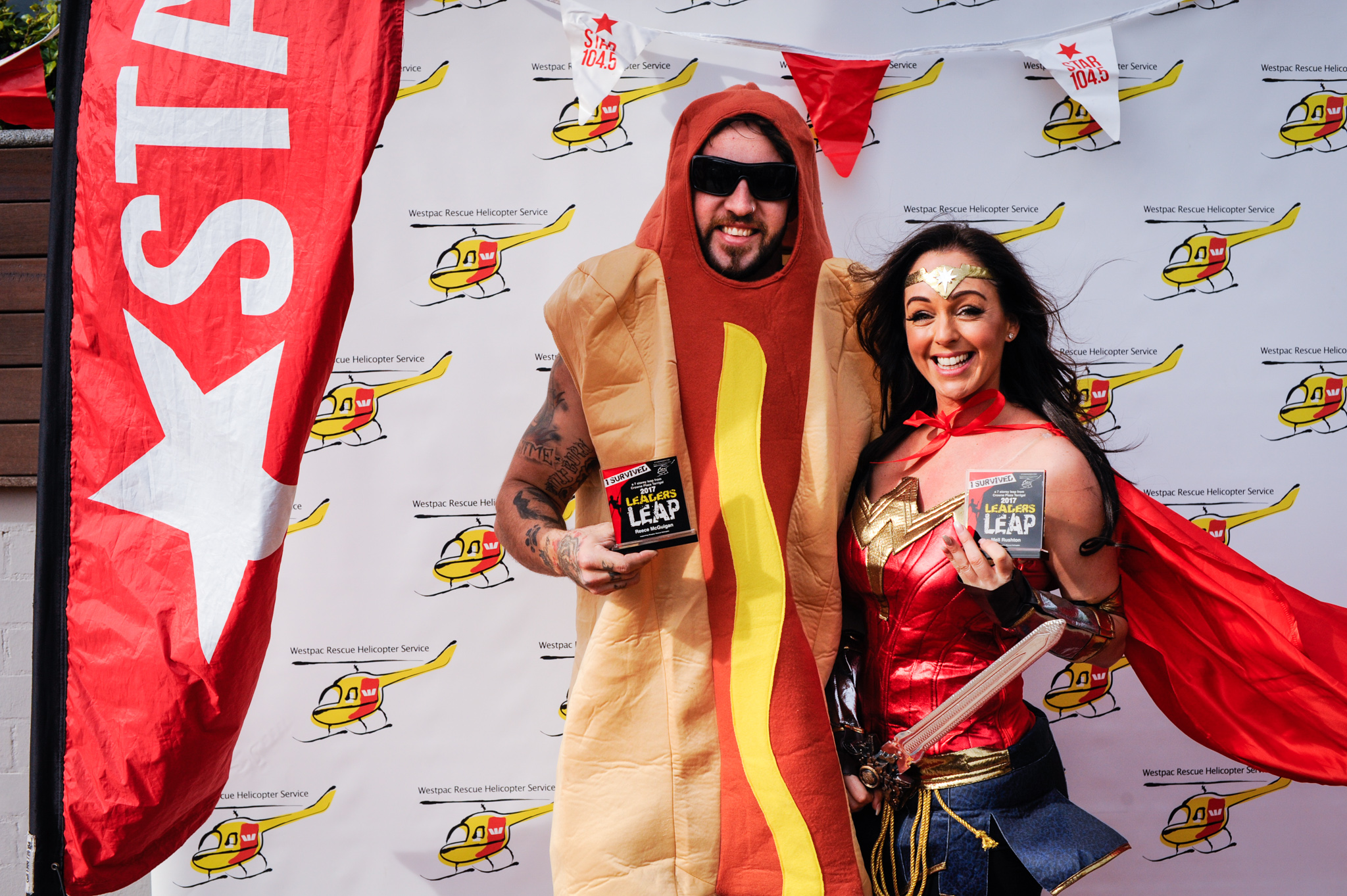 Reece the Hot Dog and Wonder woman after abseiling for Westpac Rescue Helicopter
