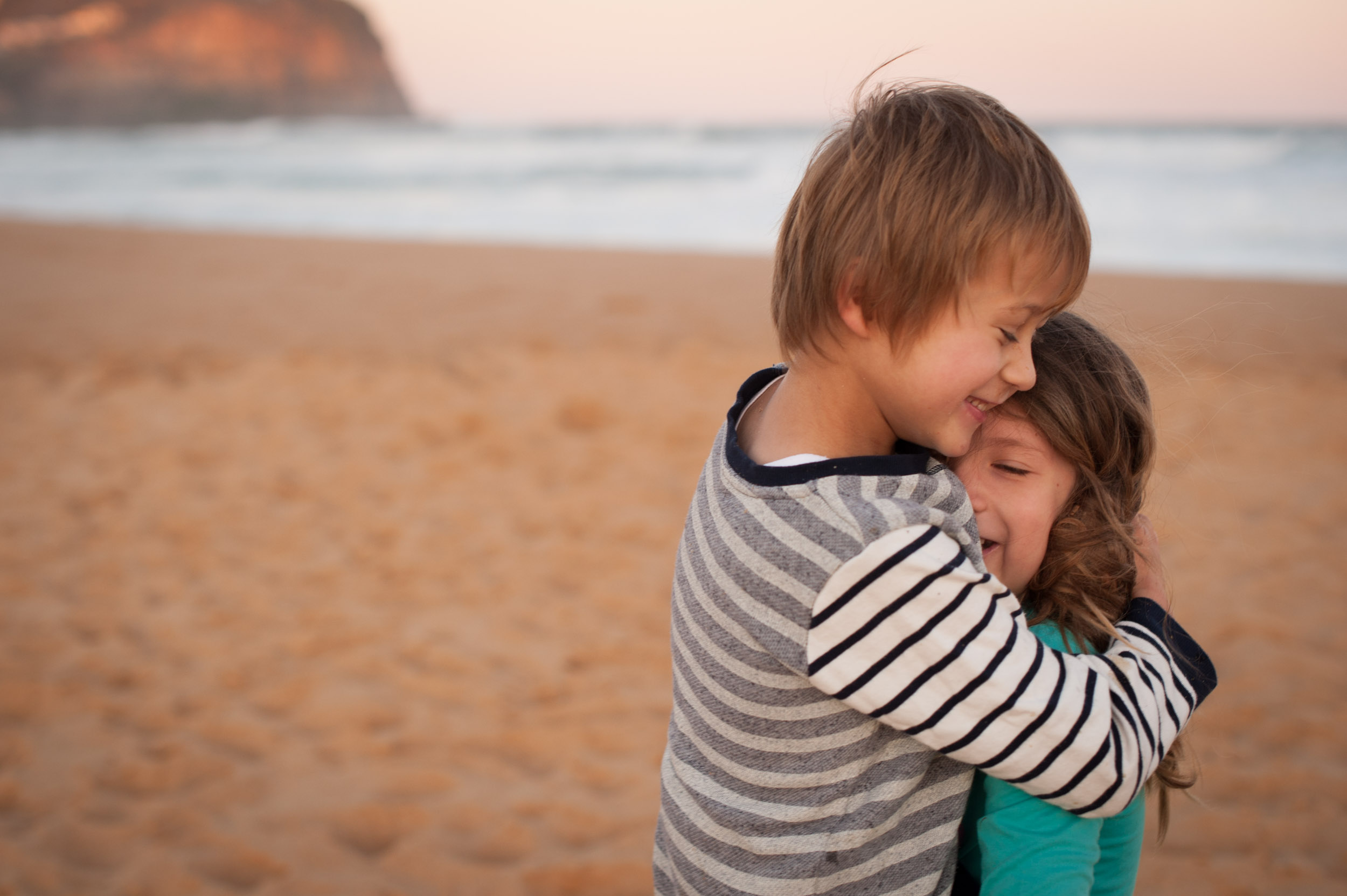 Brother and sister hugging at Copacabana Beach NSW
