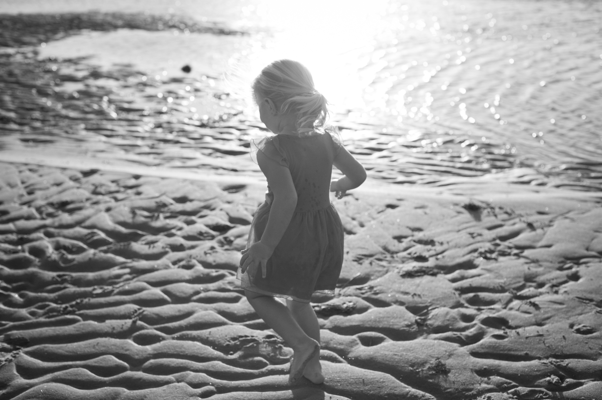 central coast family photographer little girl running through the water