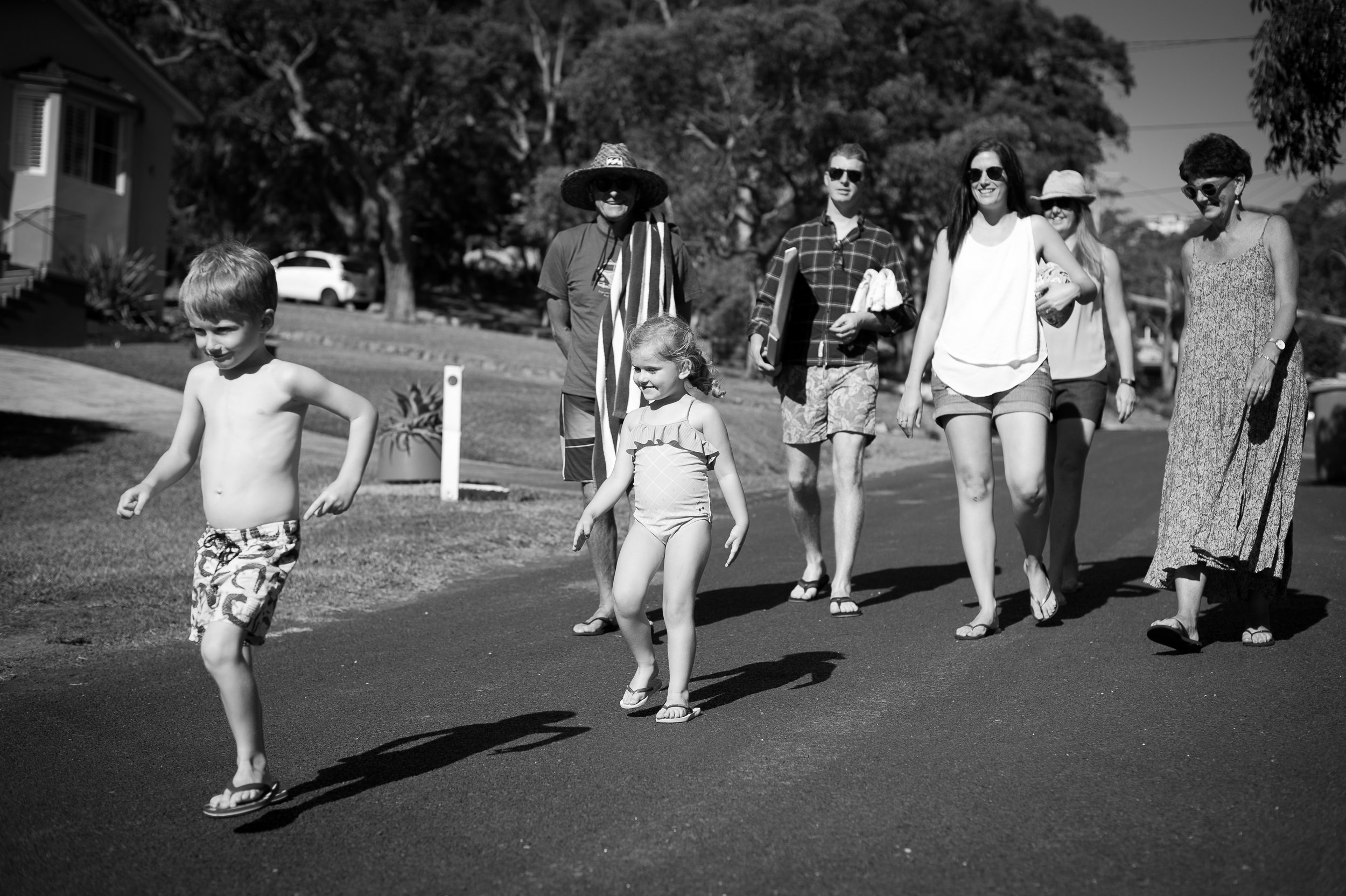 family walk to the beach copacabana nsw