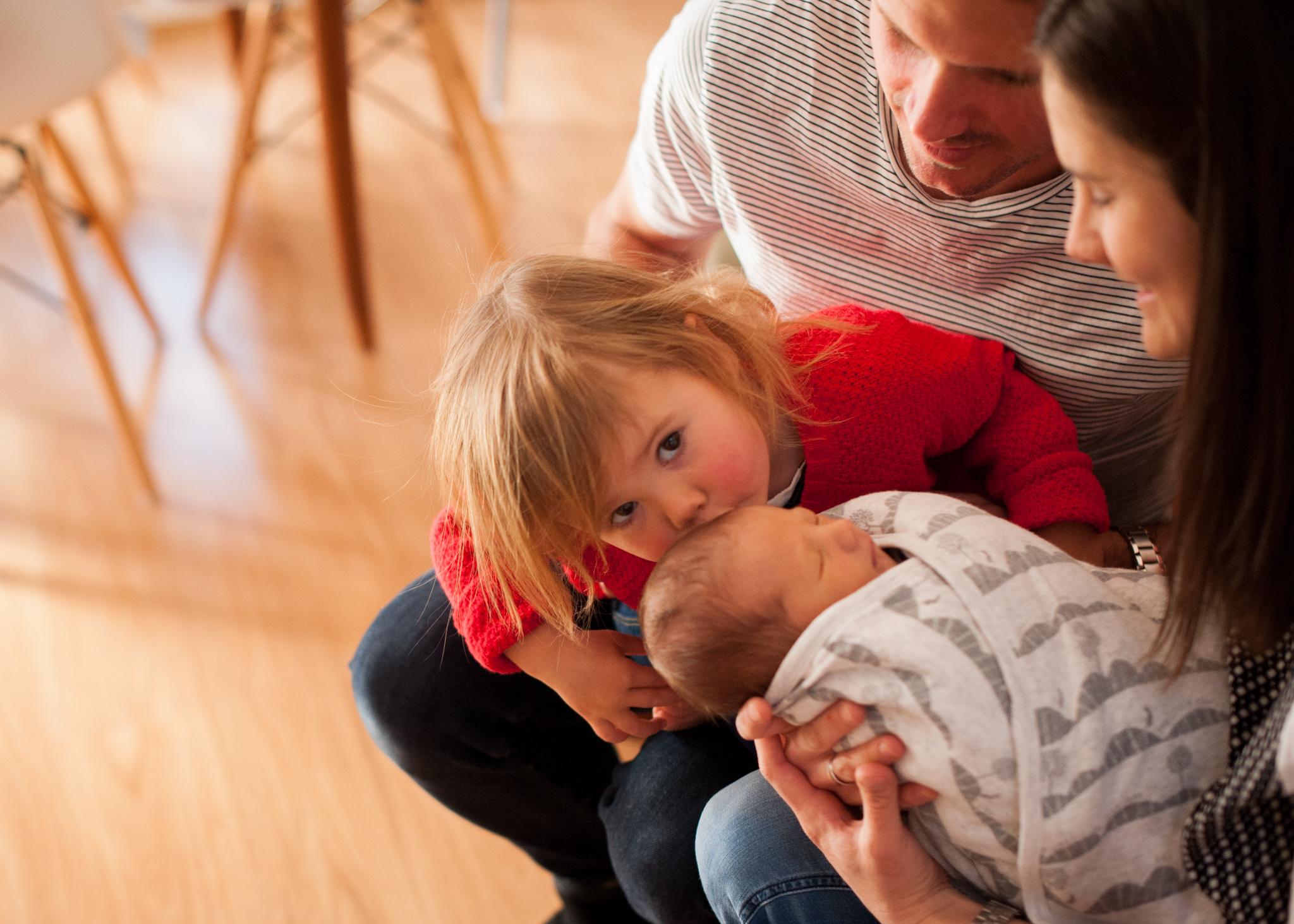 big sister kisses natural newborn photos