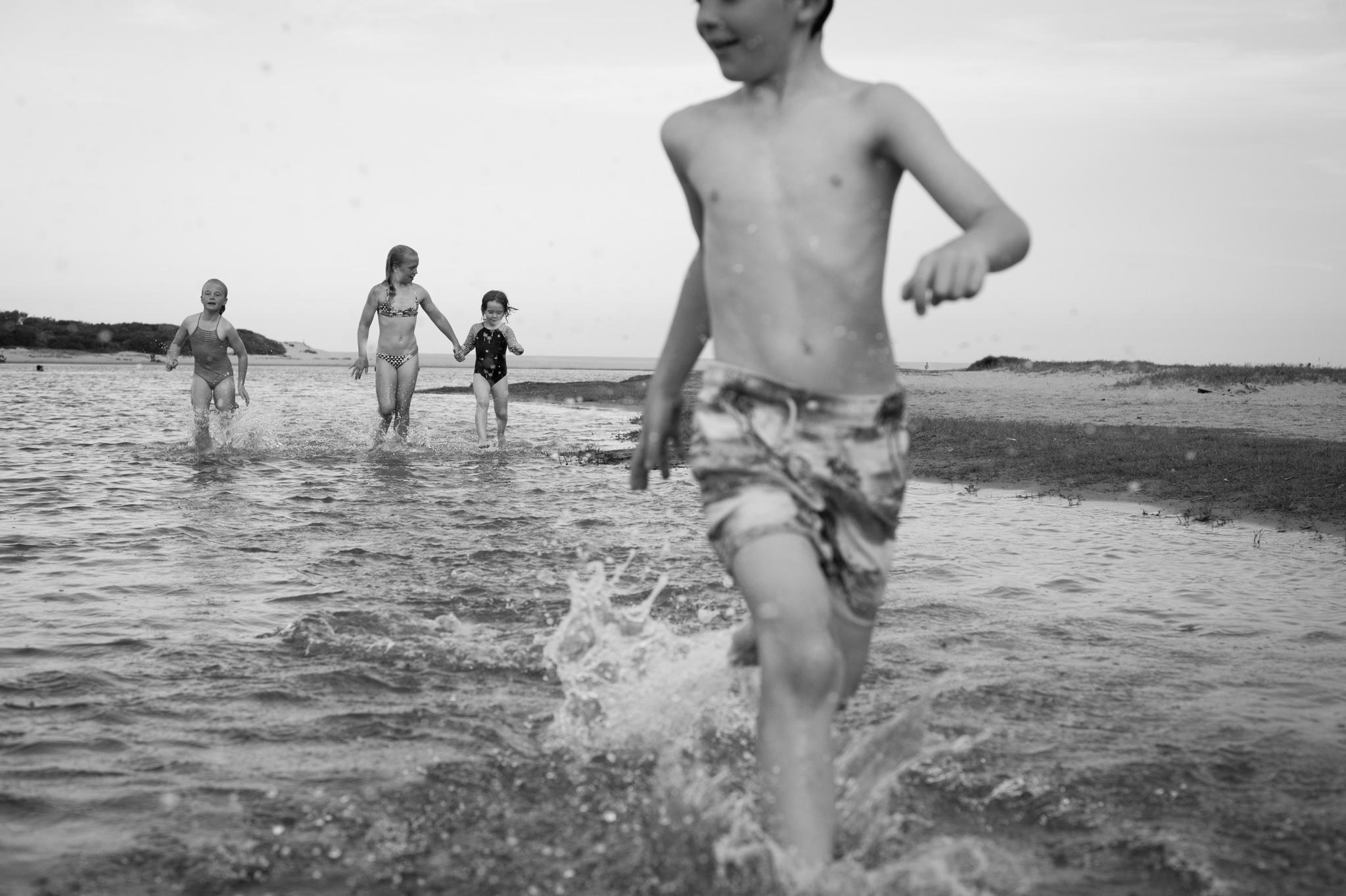 kids running through the lake avoca beach nsw