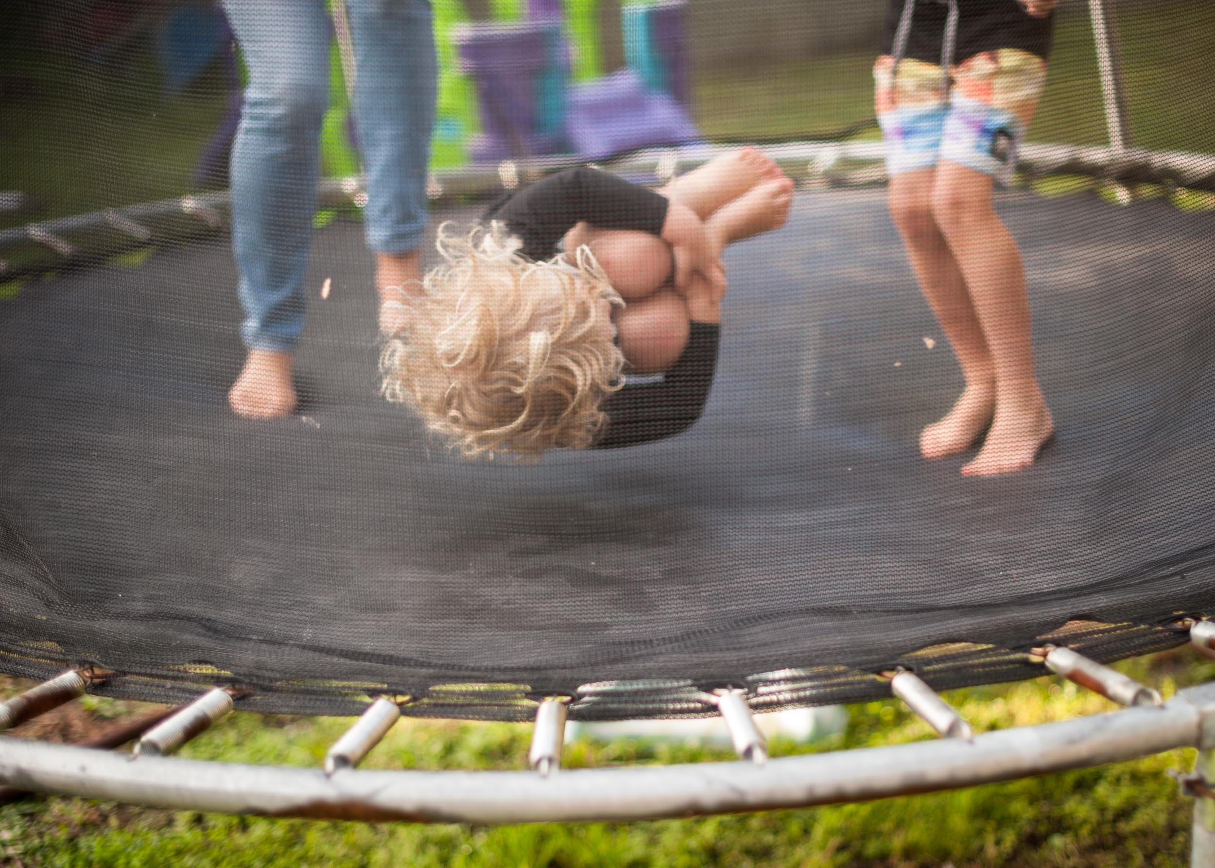 jumping on trampoline fun documentary photography