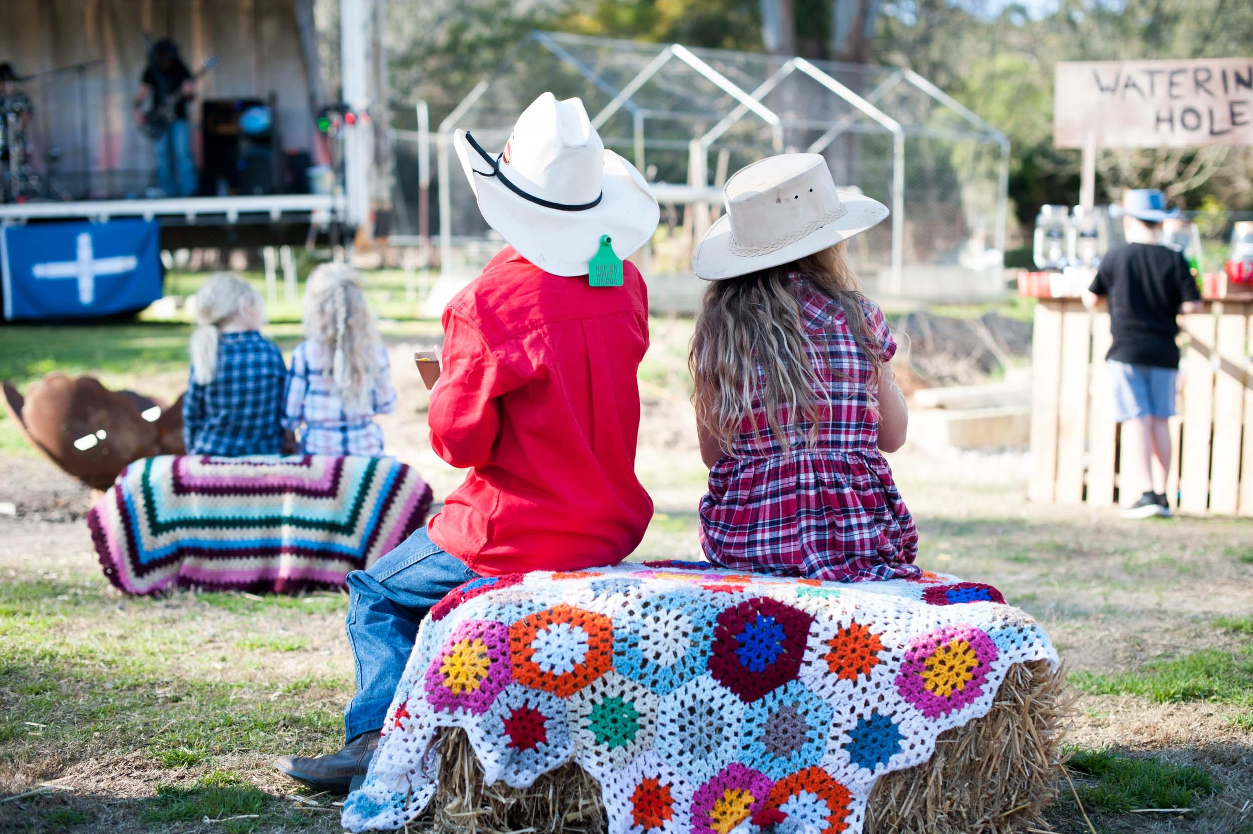 Haybales and cowboy hats