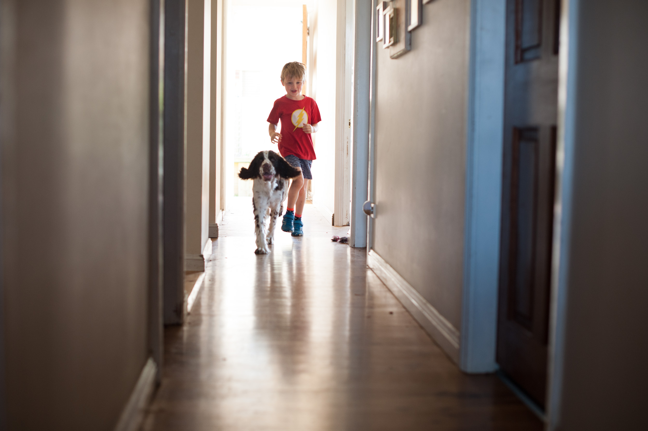 running down the hallway in home family photography berkeley vale