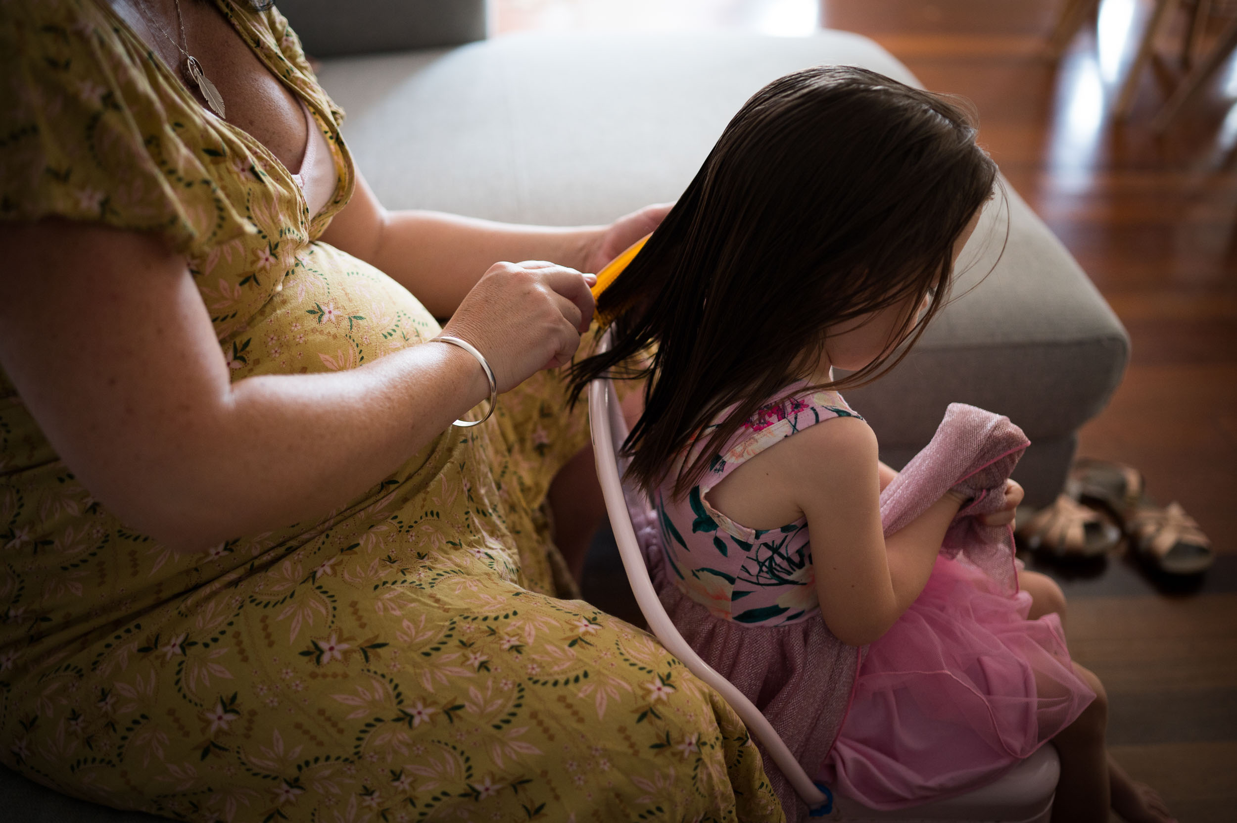 mummy brushing daughters hair central coast family photographer