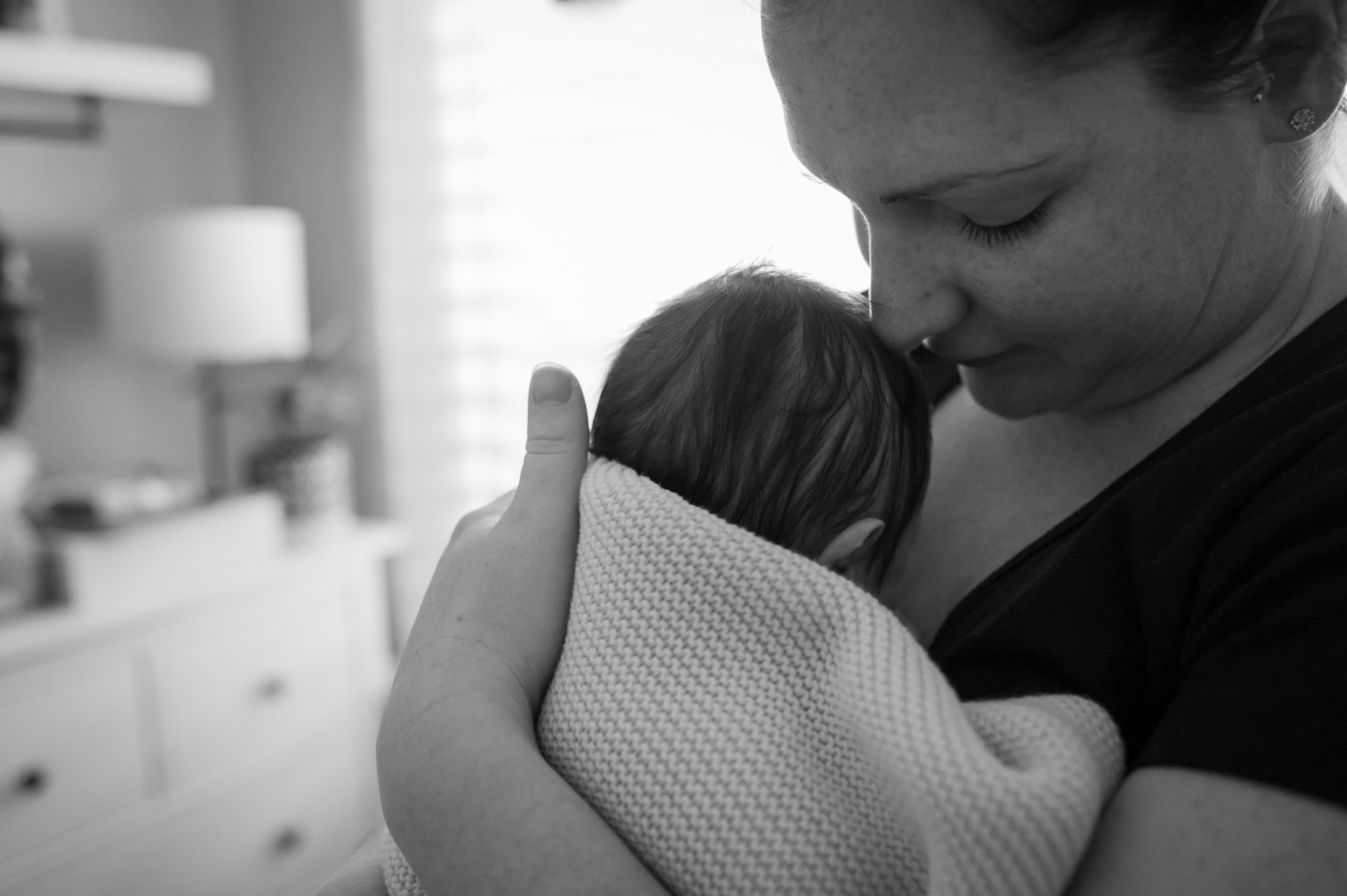 mummy cuddling newborn baby
