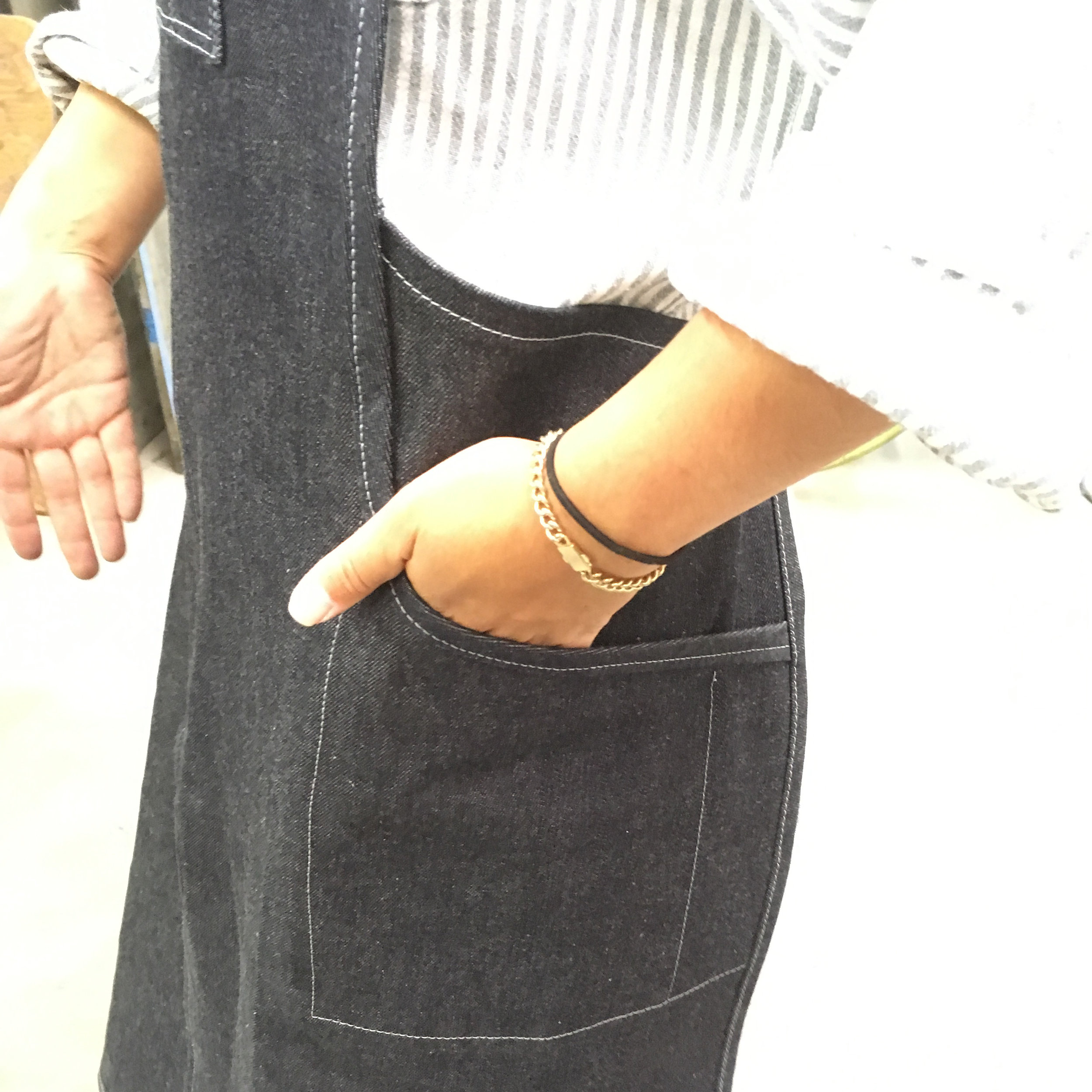 Details - American selvedge cone denim from the (now closed) White Oak mill. Split leg so you can jump on a bike for a test ride. Soft lined 'phone' pocket, button hole headphone access, big side pockets, stainless hardware and broad shoulder straps for