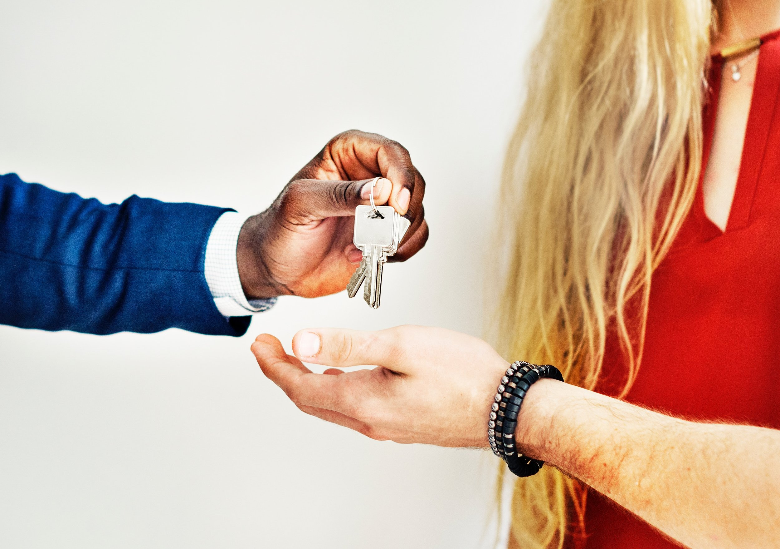 I know this picture shows an exchange of keys between two men with the woman standing aside, but I put it here because in my search for images showing homeownership, this is the majority of photos. It's typically a couple, with the man taking the keys, or it's just a man taking the keys.  This needs to change. Stats show that women are outbuying men these days in the real estate market.