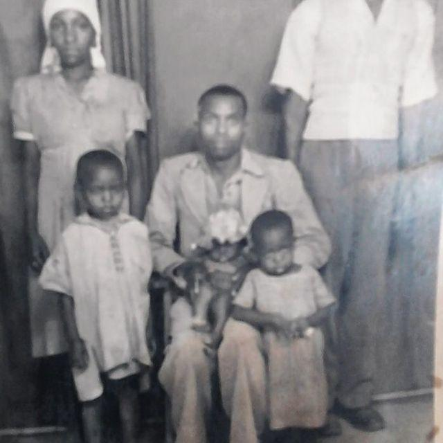 Figure 1:My grandfather holding my dad who was a few months old. Standing beside is my grandmother and in front is my Uncle Stephen and Aunty Lucy.