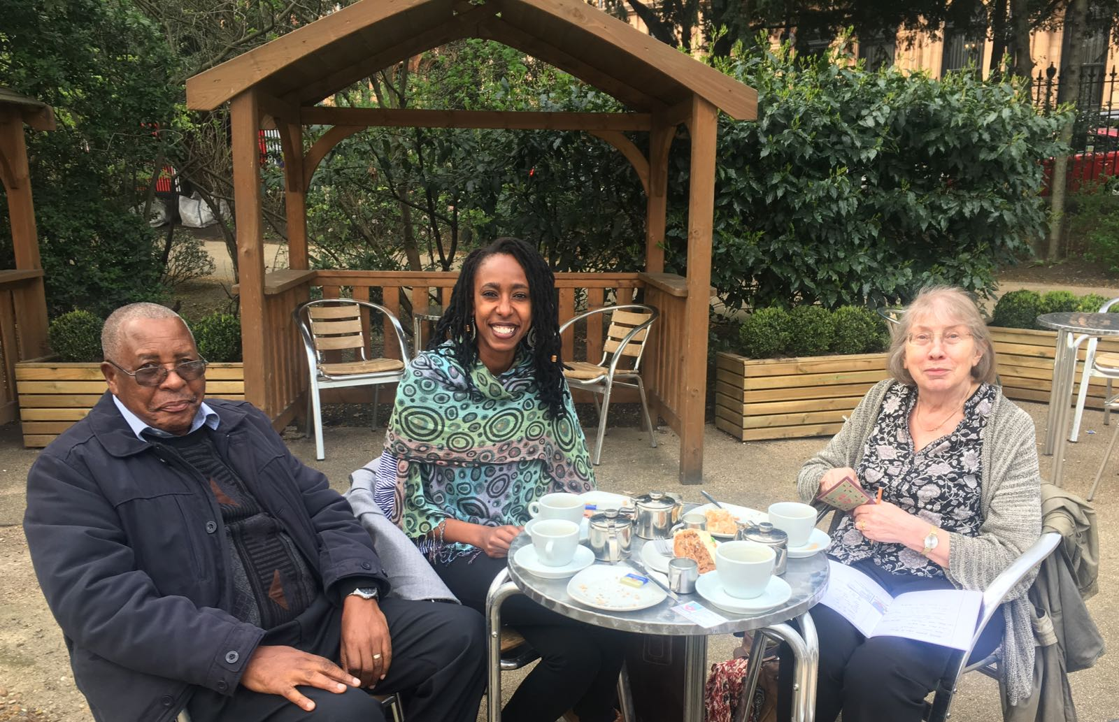 Chao (centre) and Olivia (off camera) talking archives with Nathan Mnjama and Mandy Banton in Russell Square, London.