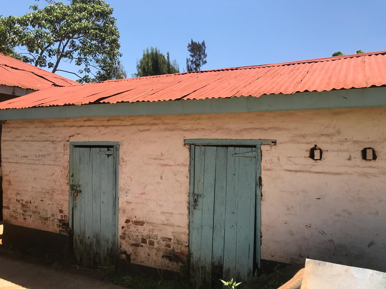 Solitary cells as they appear today in Kangubiri Girls High School (formerly Aguthi Works Camp). They are presently used as stores. Notice the doors turned upside down.