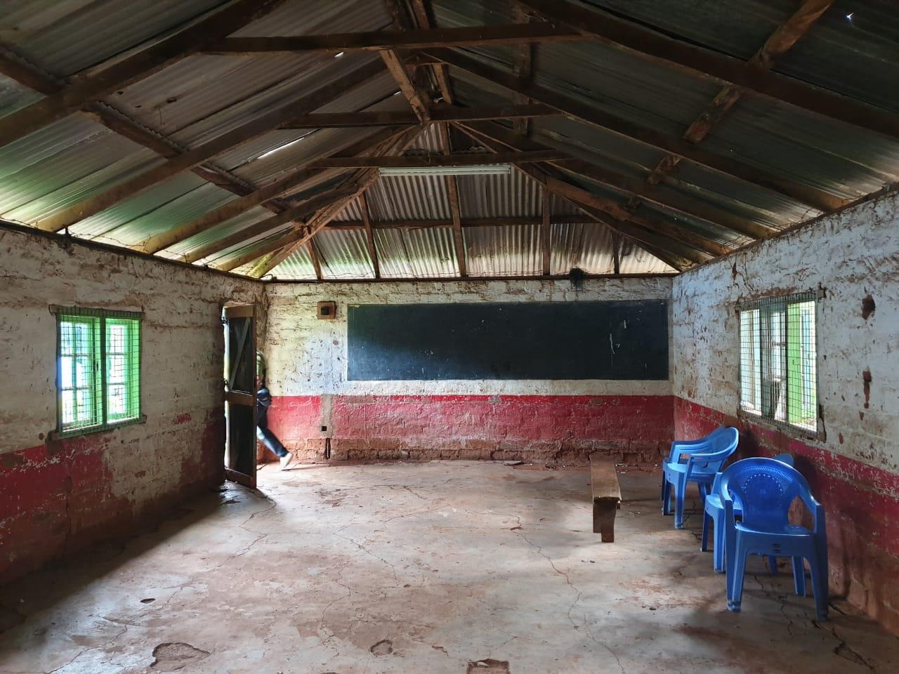 Figure 9: Interior of class room, notice barbed wire along the roof. Mweru High school.