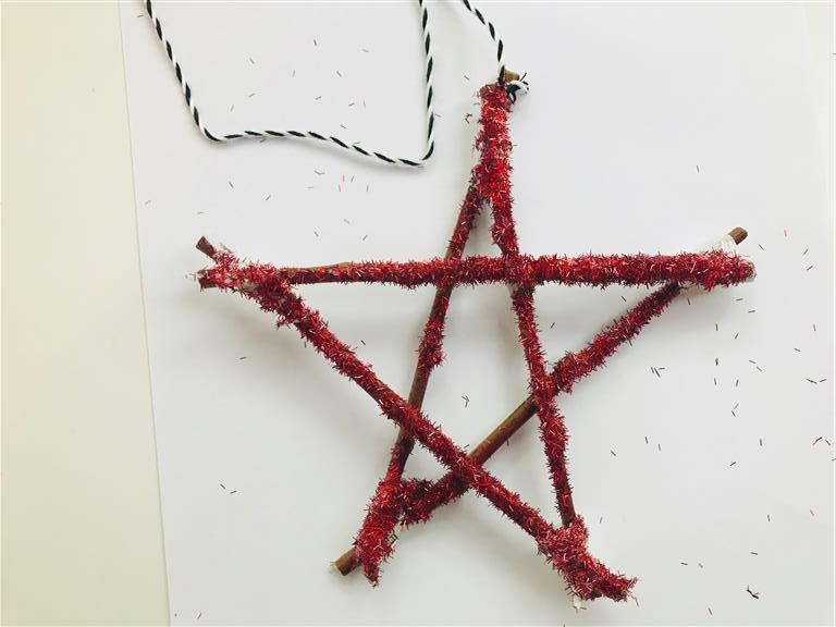 Step 11: Add twine to hang your star from your Matariki tree
