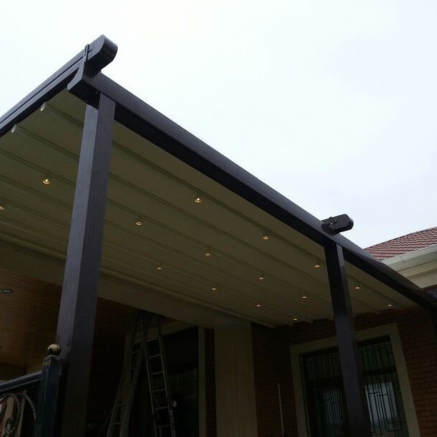 Retractable roof system with lights and rain gutter
