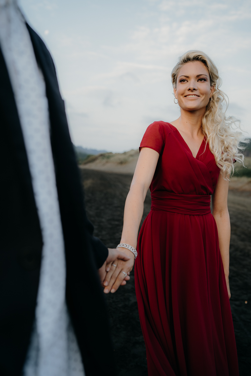 Any beach in New Zealand are beautiful and  Bethells beach  is one of them, I use it to capture  engagement shoots, couples or portraits . Image captured by Kenny Chick who does  Auckland wedding photography. A wedding photographer based in Auckland