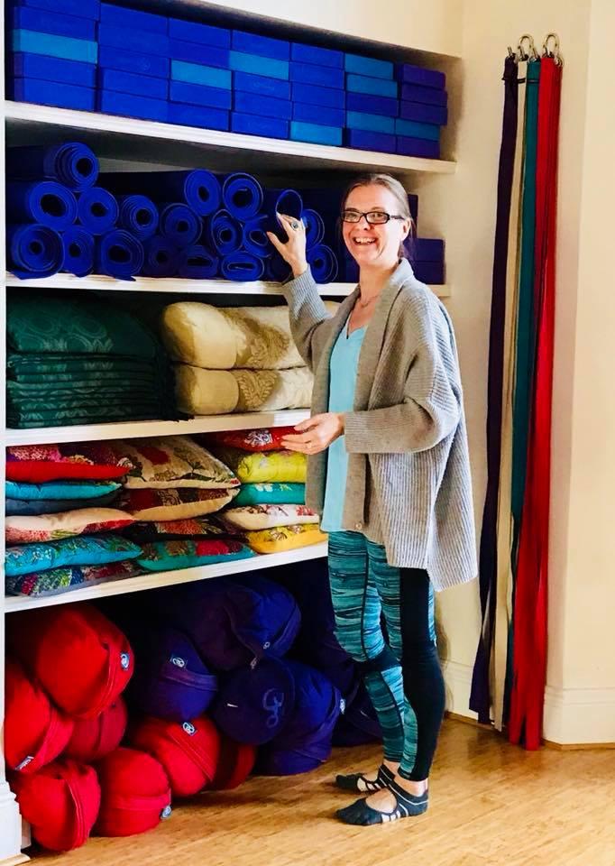 Susan Bradley prepares for Slow Down Yoga