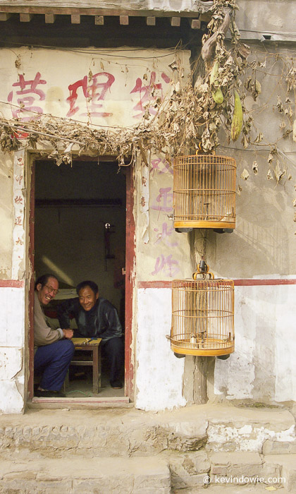 Doorway and bird cages, Kaifeng, China
