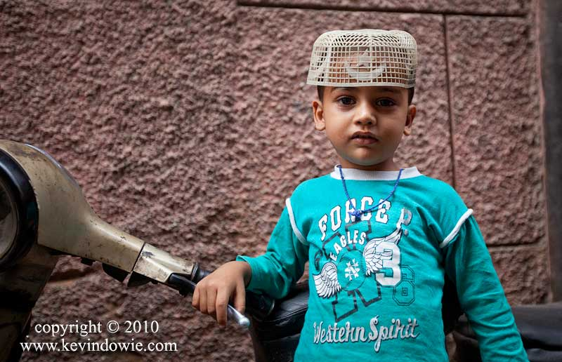 Boy in plastic cap, Old Delhi