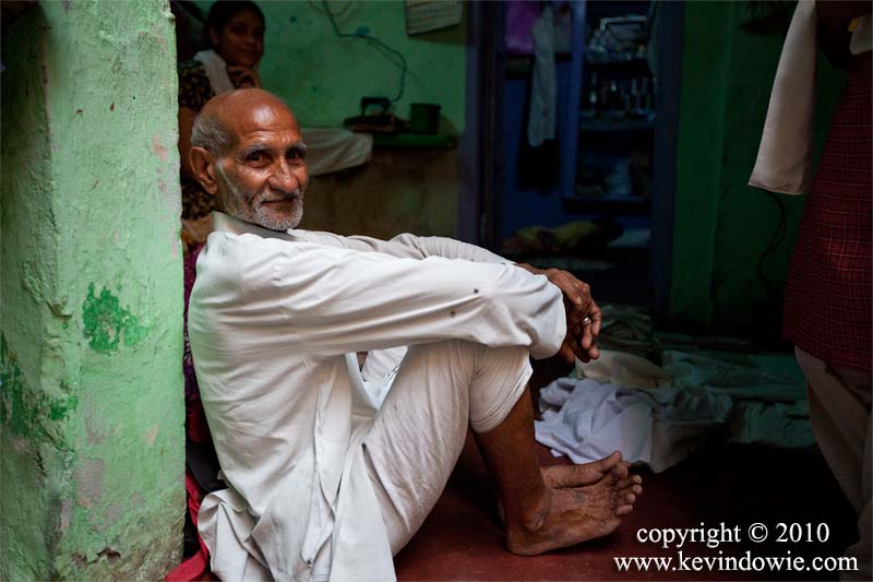 Man sitting in doorway, Old Delhi.