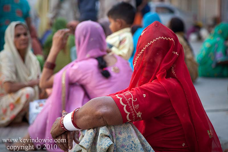 Woman in red veil, Haridwar, India.