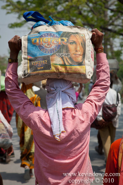 Man carrying load on his head, Haridwar.