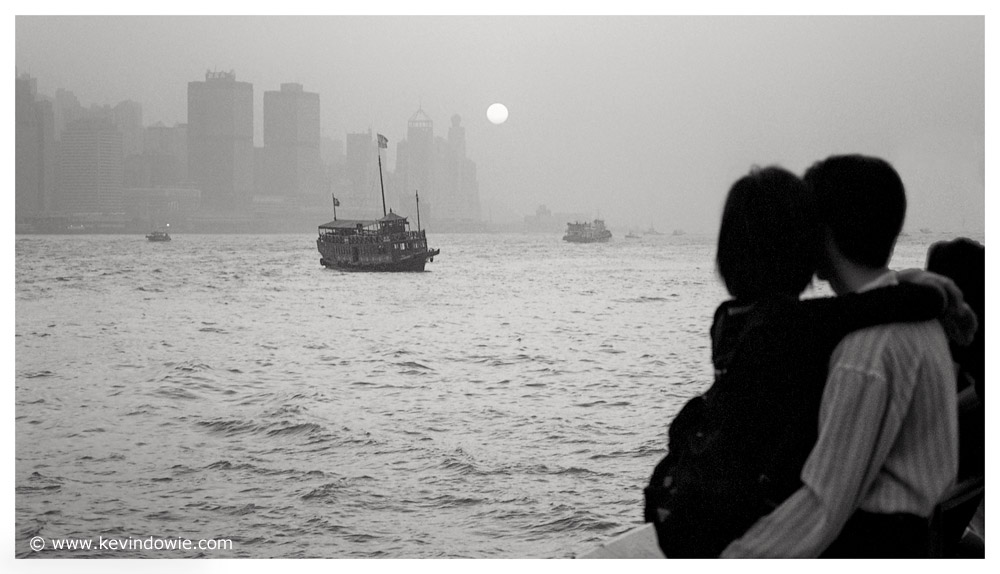 Young couple overlooking Hong Kong Harbour.