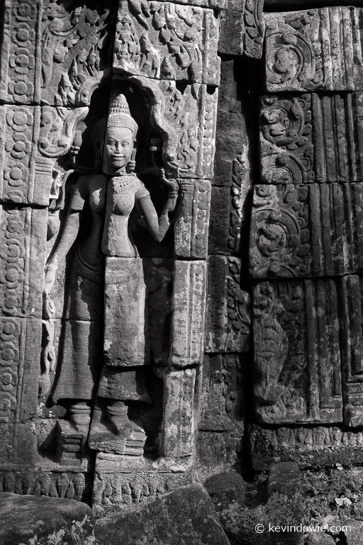 A fractured apsara. Thousands of apsara carvings have been catalogued among the Ankorian temples in the region. They have dozens of different forms and interpretations.