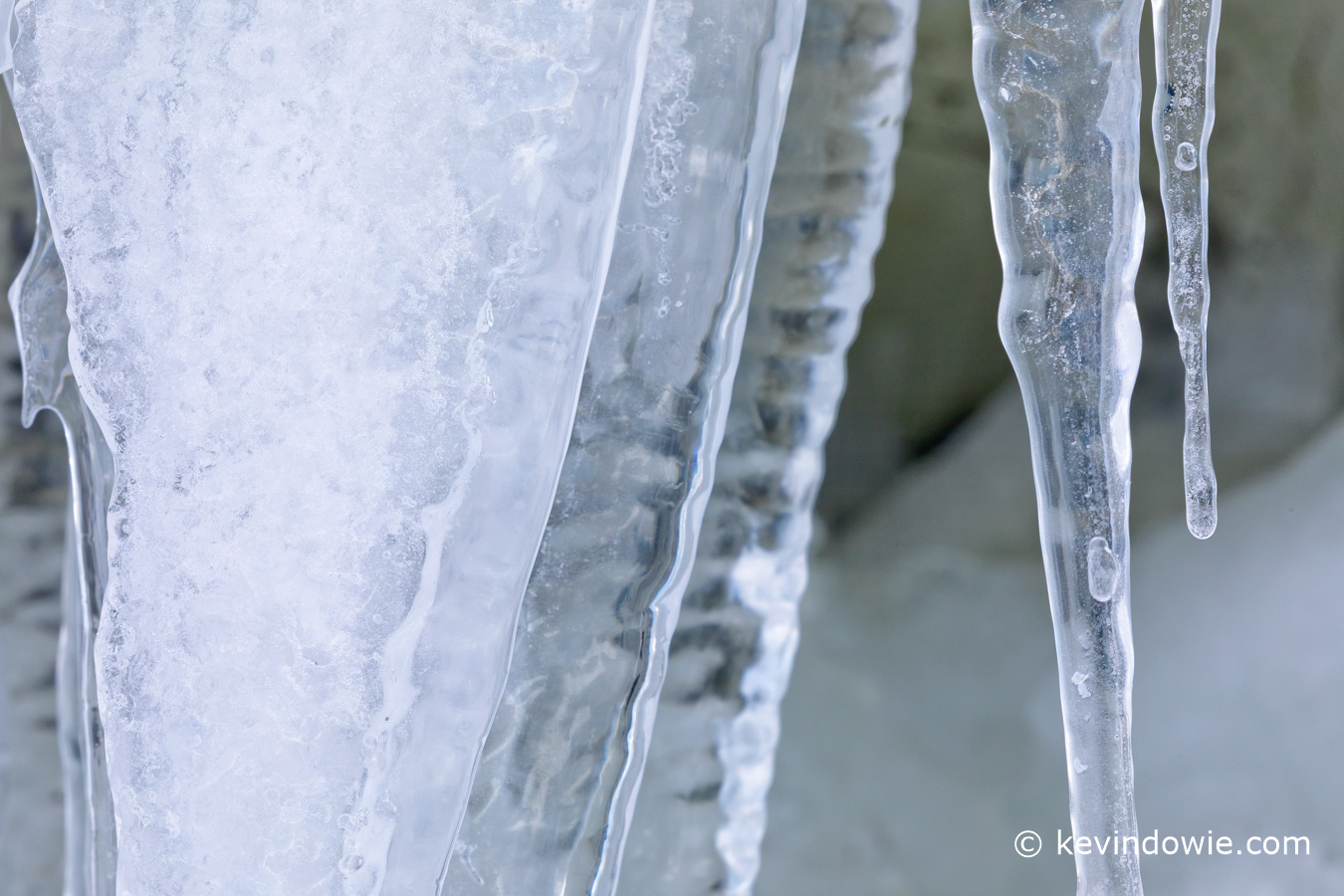 Icicles hanging at the entrance to a small cave, Antarctica.